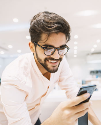 Man looking at phone in store