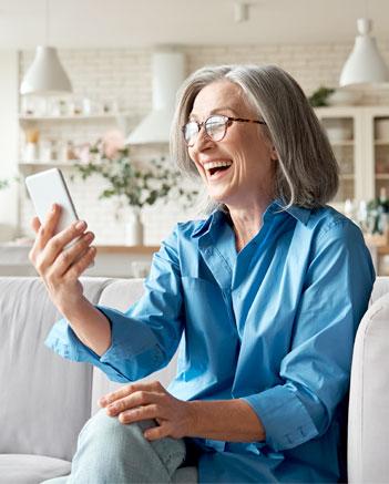 Woman looking at phone at home